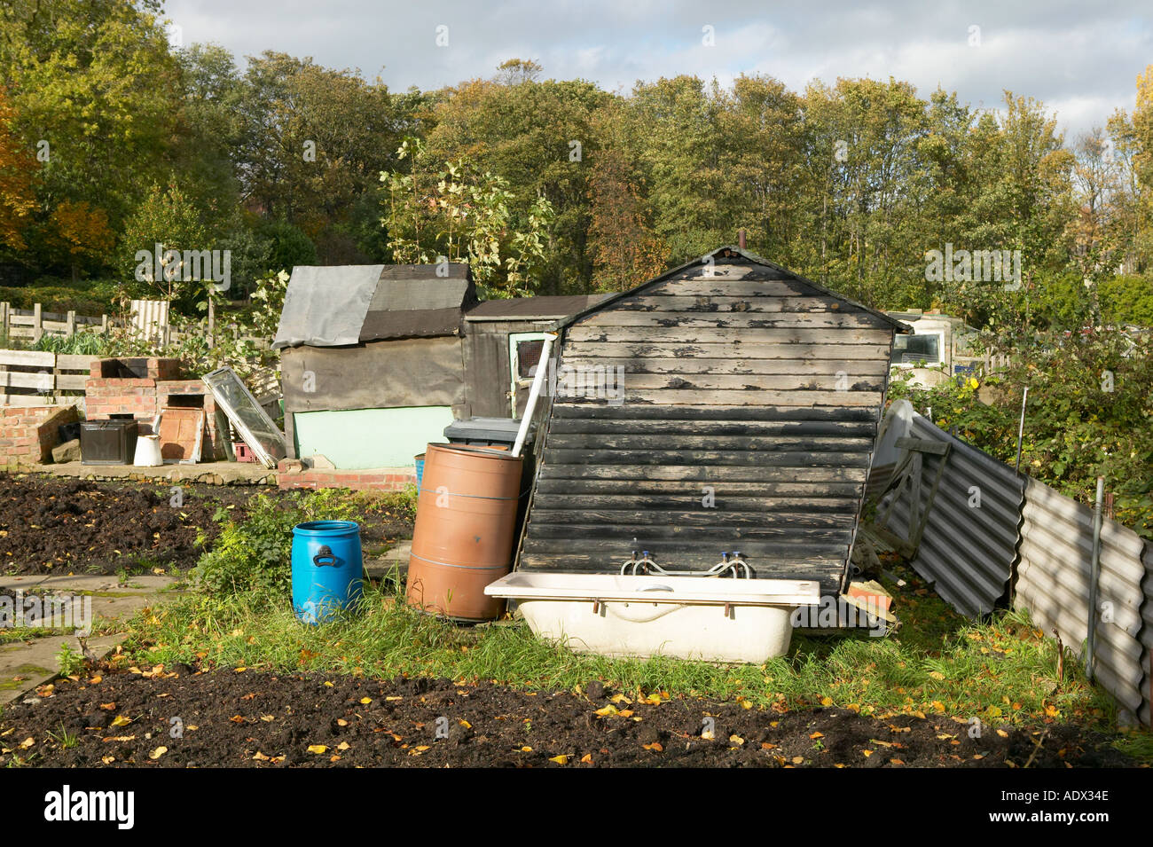 leaning shed and old bath on garden allotment stock photo 2515789