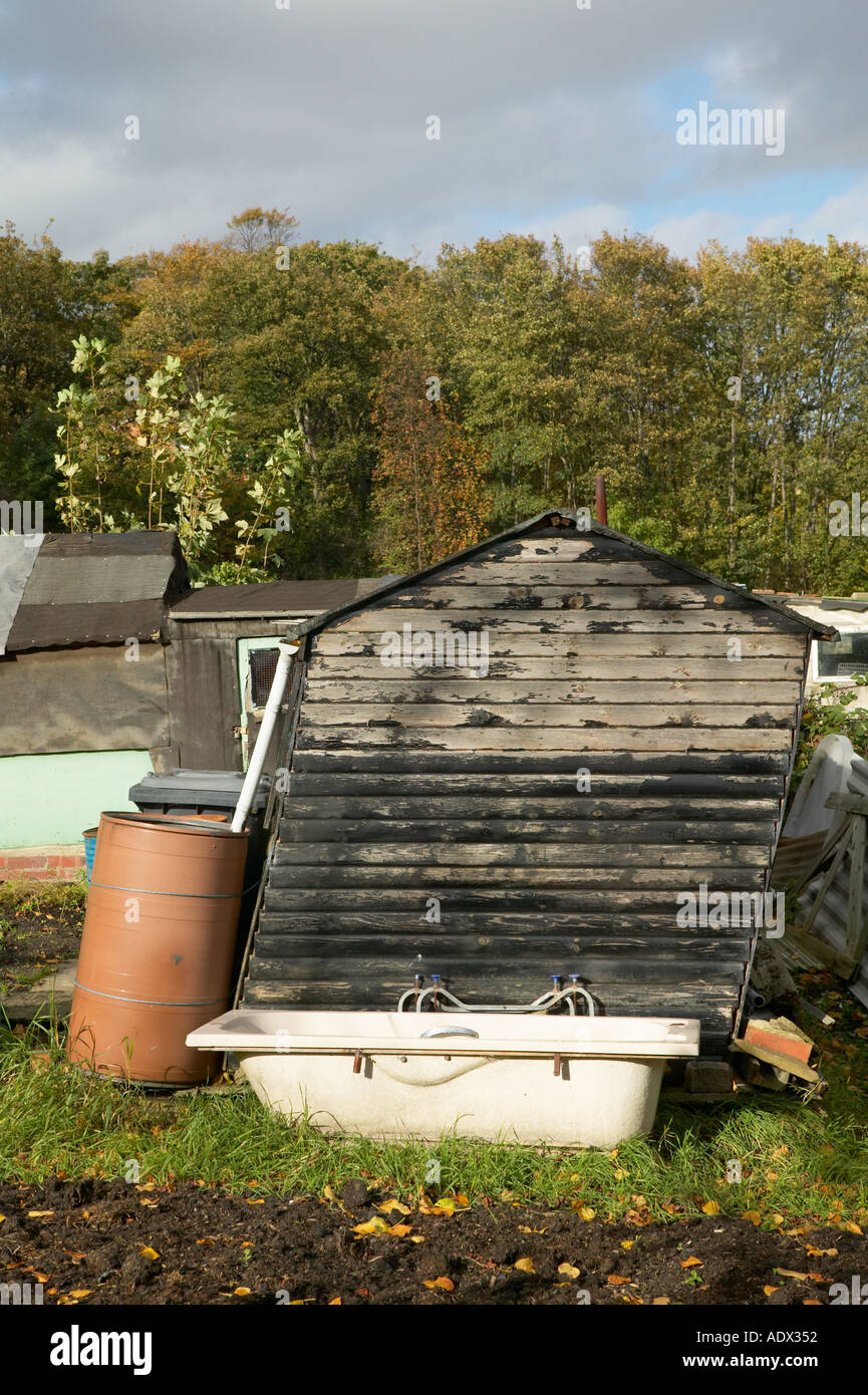 leaning shed and old bath on garden allotment stock photo 2515793
