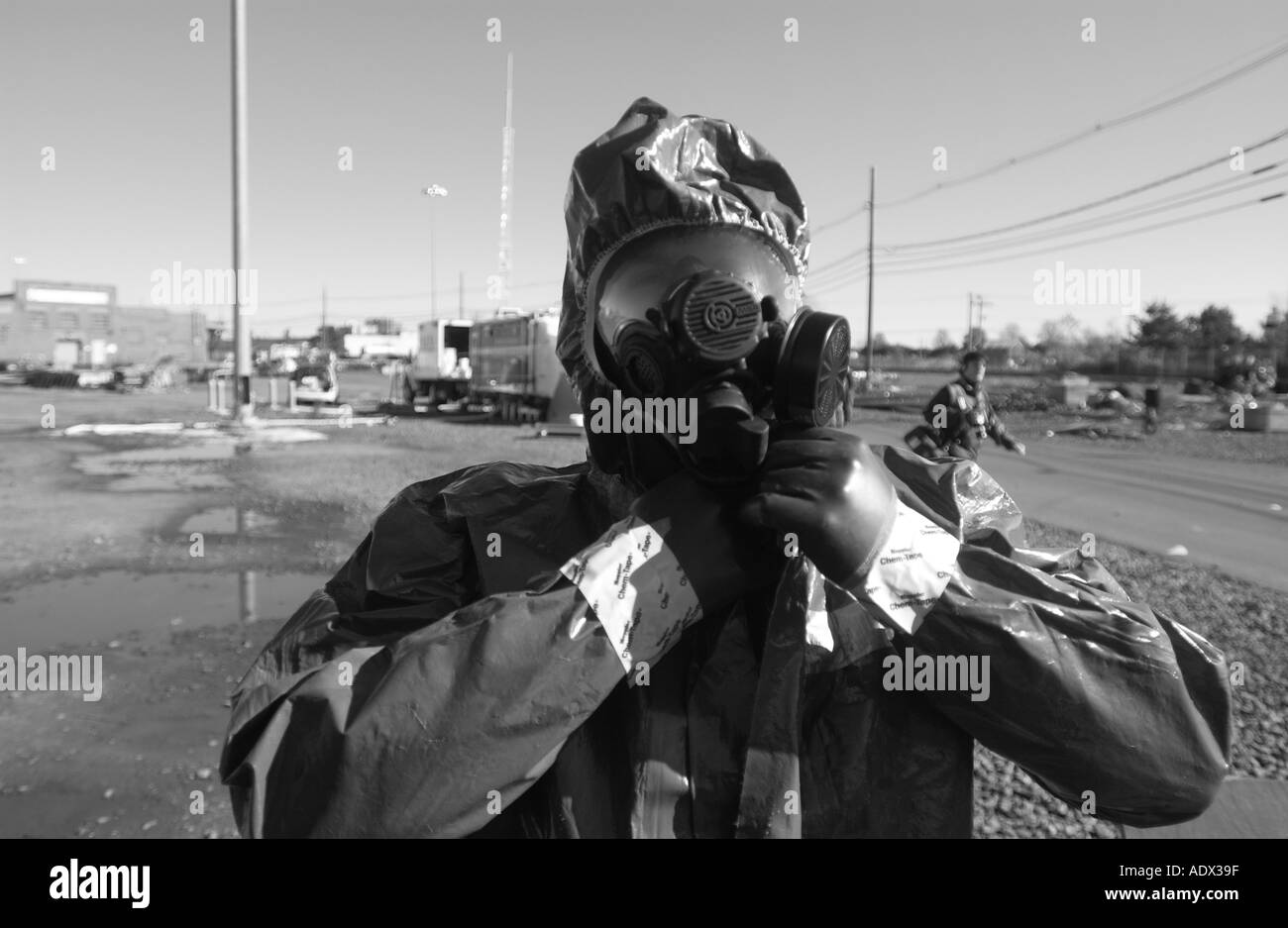 Firefighter with biohazard emergency gear mask and suit - Stock Image