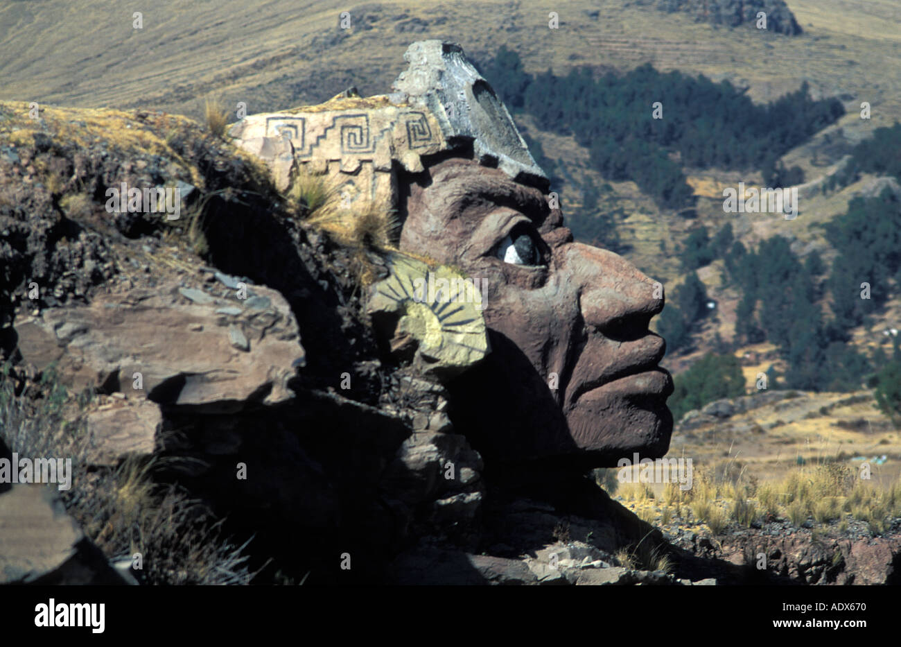 Massive stone carved inca heads flank either side of