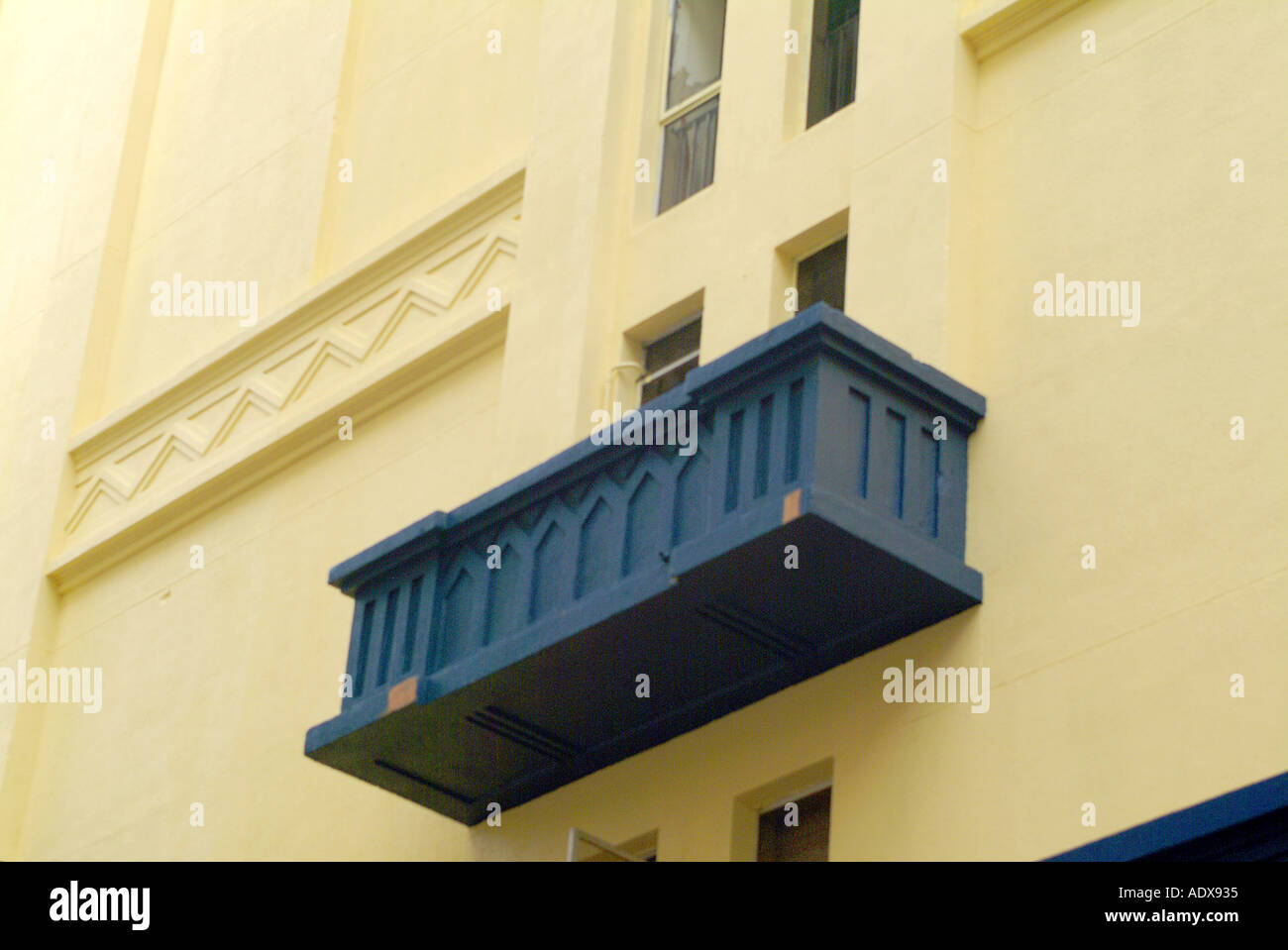 Architecture balcony art deco restored preserved windows yellow blue facade frontspiece architectural wall 50 s stylish style - Stock Image