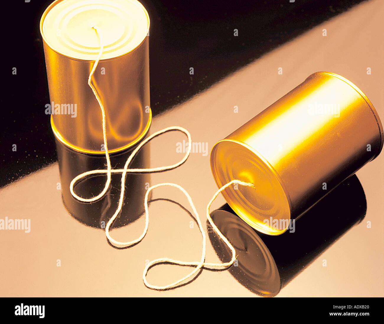 Concepts tin tins can cans string archaic phone toy play yellowish leisure concept miscellaneous background texture - Stock Image