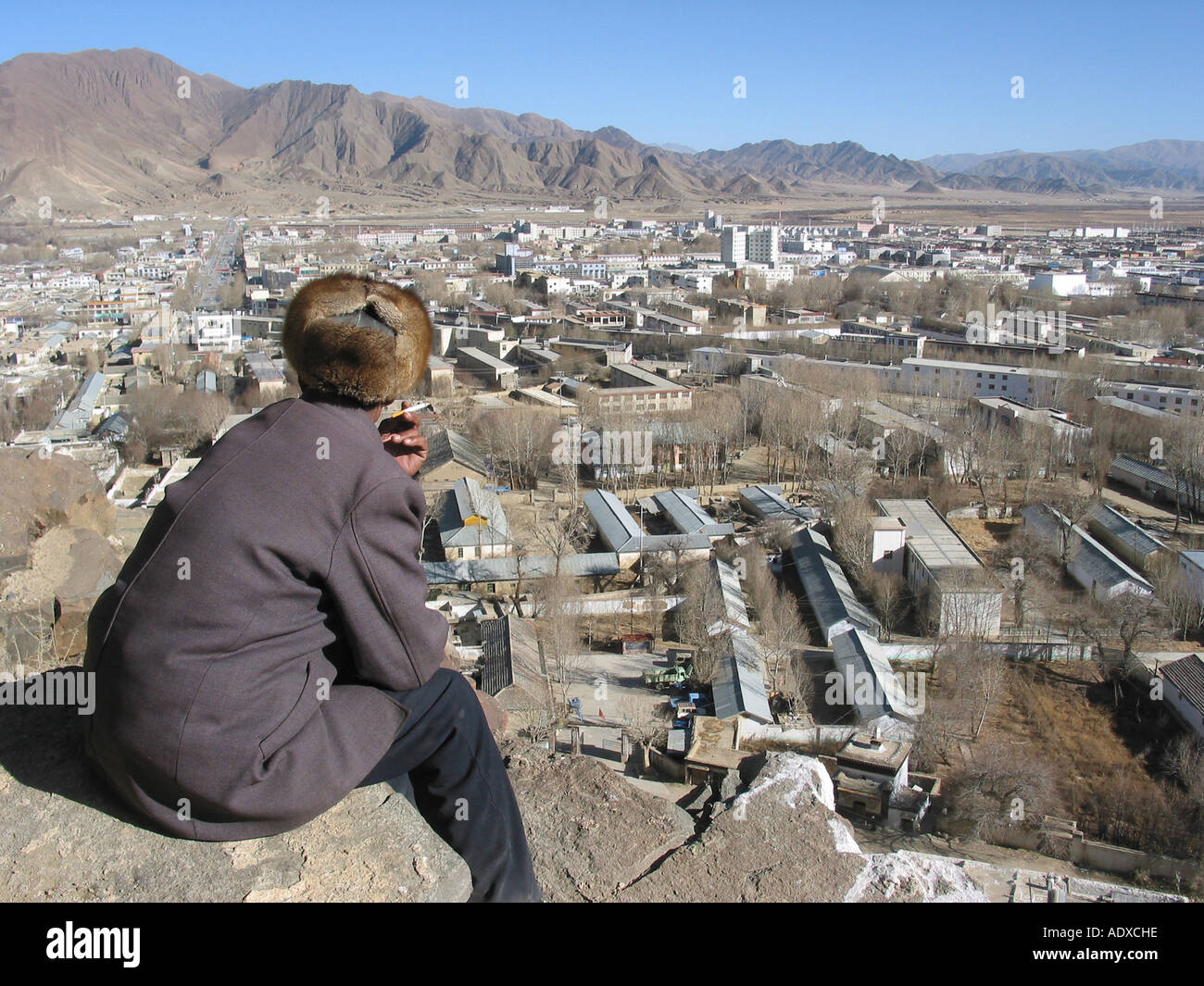 Man is looking at the skyline of Lhasa Tibet - Stock Image