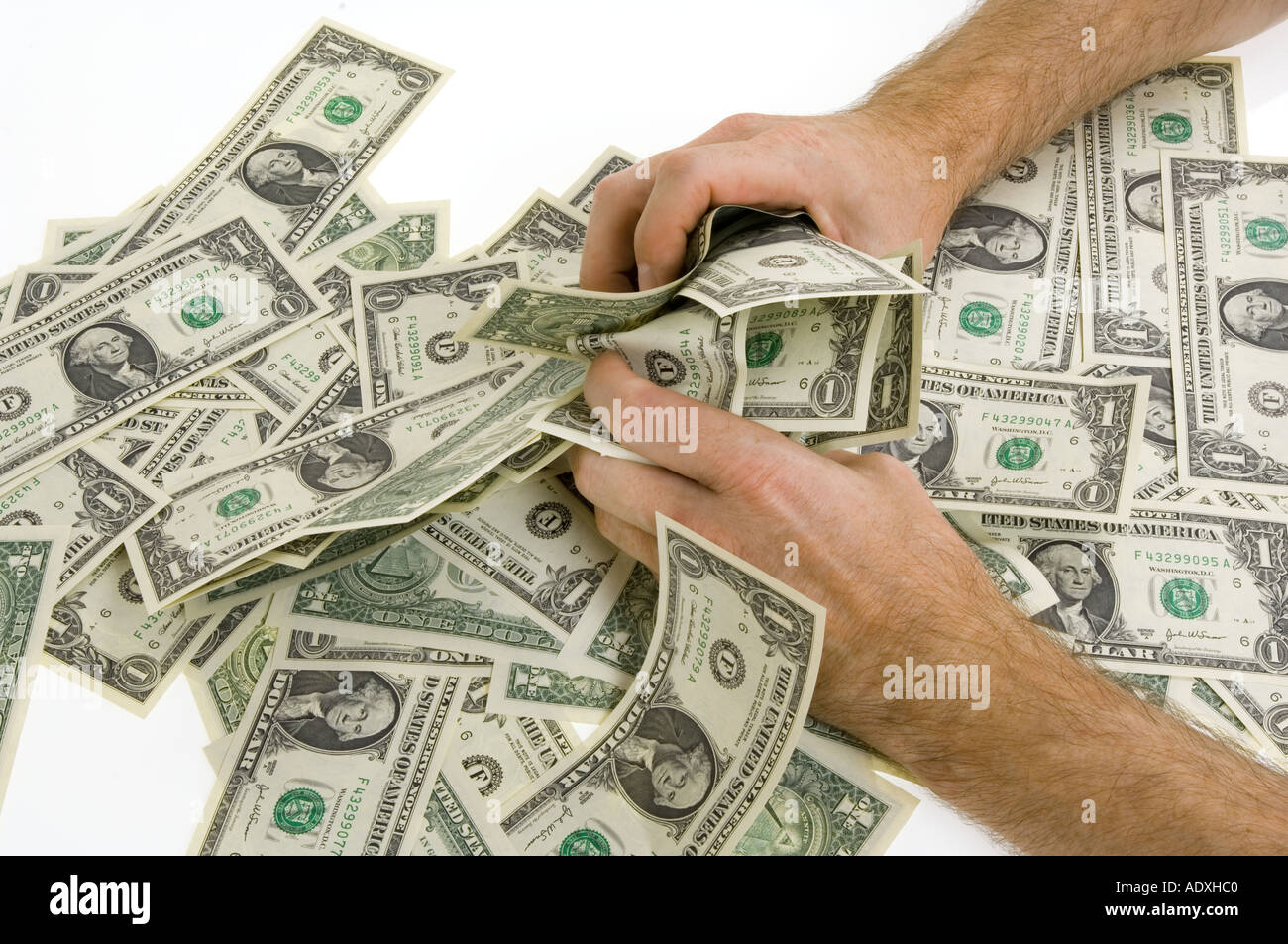 hands grab at money snatsch one dollar 1 notes currency covetousness avarice piggishness voracity greed cupidity ravenousness  Stock Photo