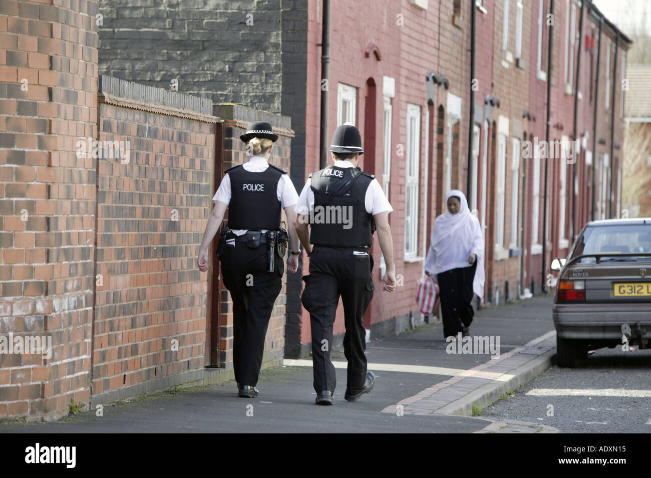 Police patrolling the streets of Tipton in the West Midlands UK - Stock Image