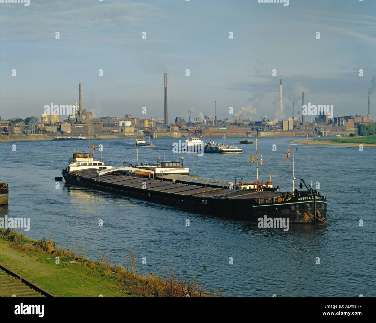 Germany; the Rhine at Krefeld-Uerdingen with Bayer Chemical Works in background. - Stock Image