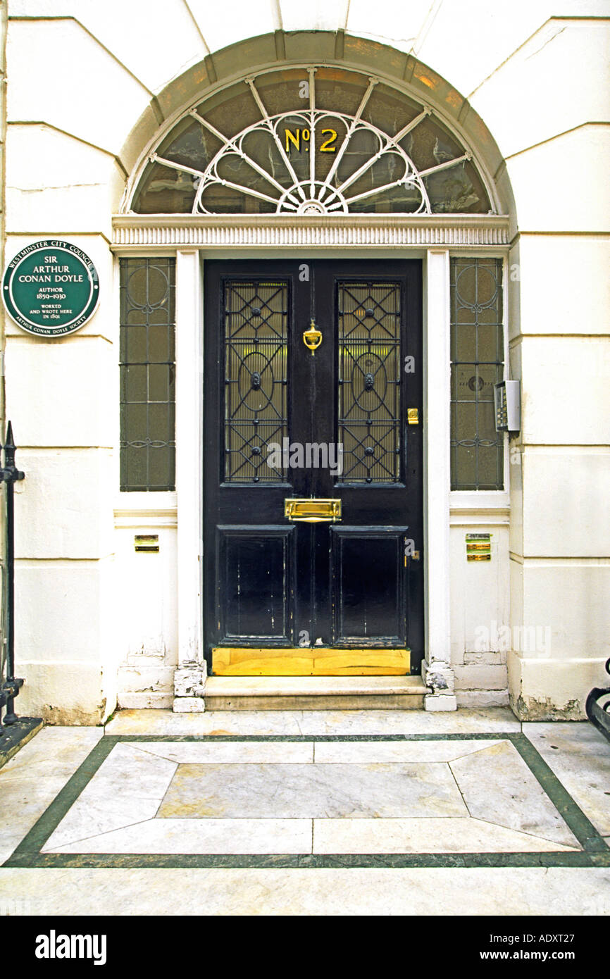The front door of 2 Upper Wimpole Street in London. Sir Arthur Conan Doyle wrote his first Sherlock Holmes stories here. - Stock Image