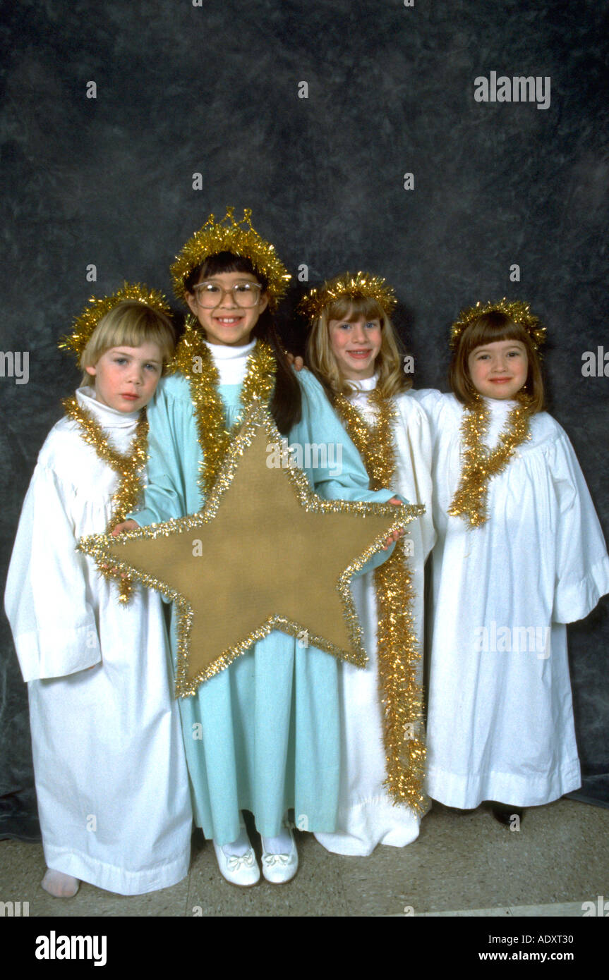 The Christmas Pageant.Angels Ages 5 To 7 Holding A Star Before The Christmas
