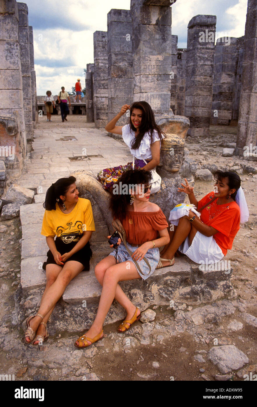 4, four, Mexican women, tourists, Temple of the Warriors, Chichen Itza Archaeological Site, Chichen Itza, Yucatan - Stock Image