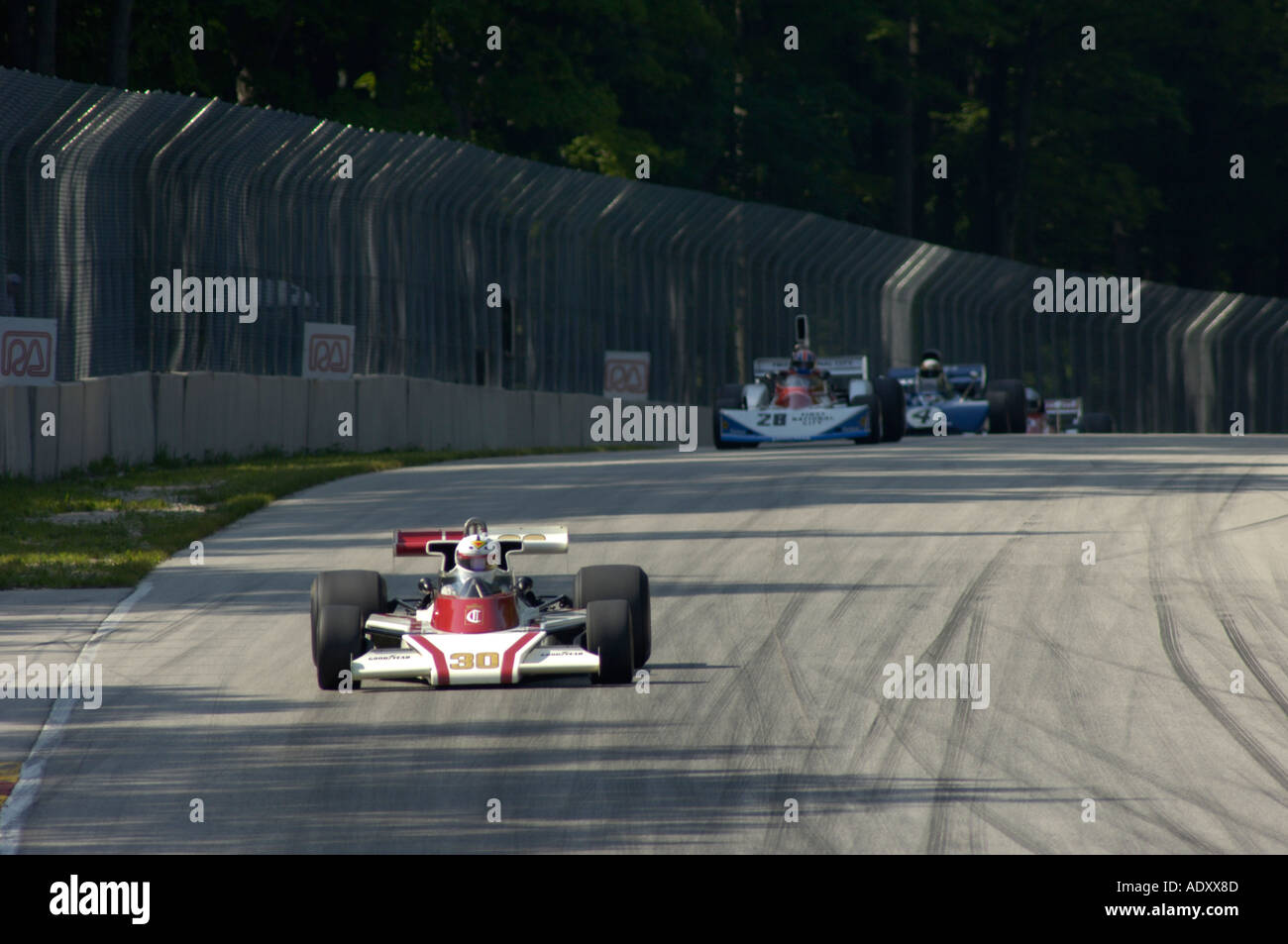 Danny Baker leads a group of vintage F1 cars in his 1976 McLaren M23F at the Brian Redman International Challenge 2005 - Stock Image