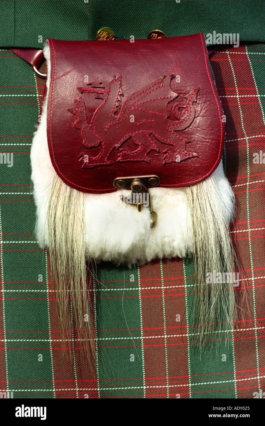 Man wearing Welsh kilt in St David's tartan with red dragon leather pouch at Cardiff Castle Wales UK - Stock Image
