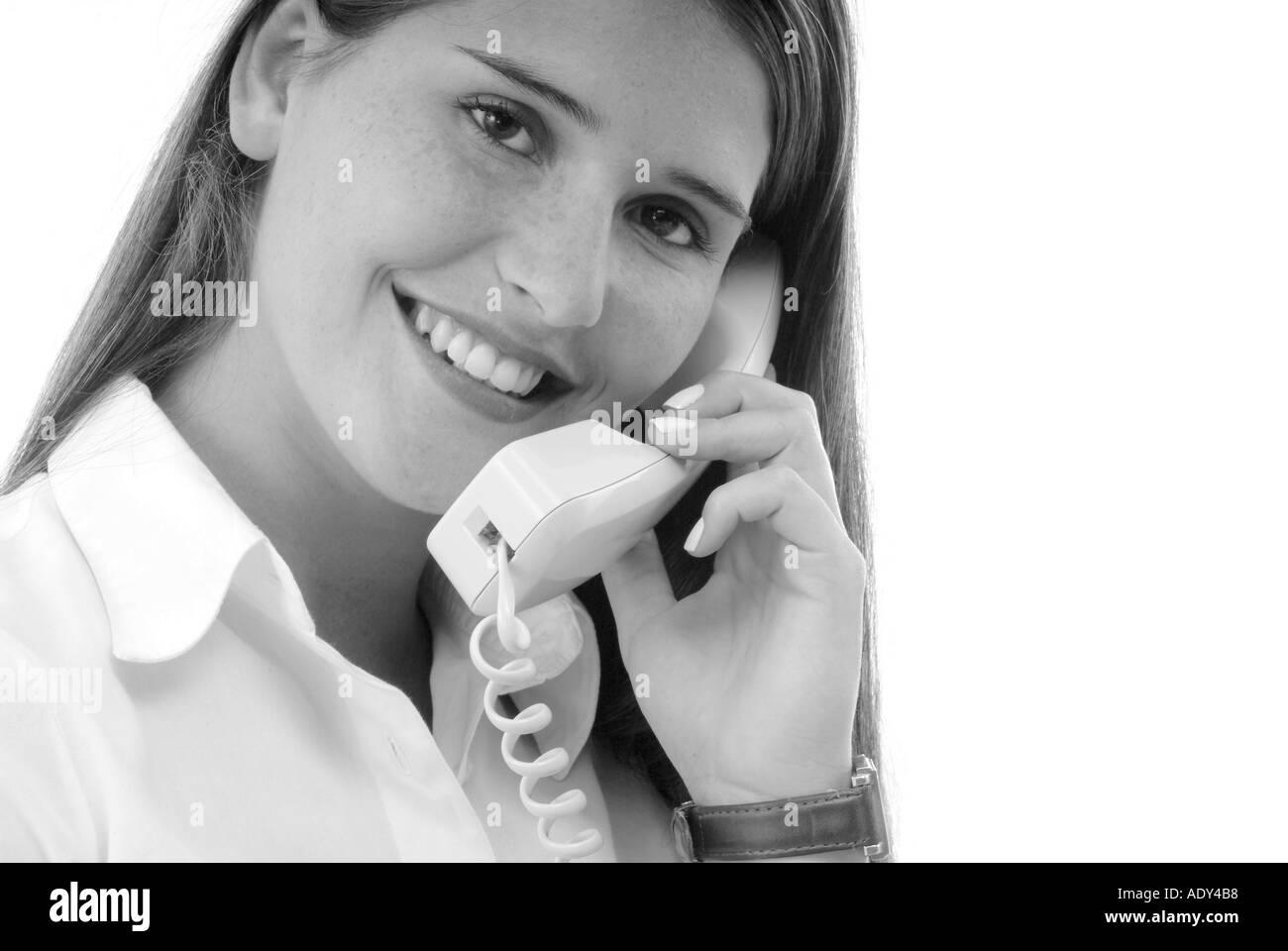 Communication woman women white caucasian cellfones cellfone phone phones telephones telephone phone mobile phones mobile mobile - Stock Image