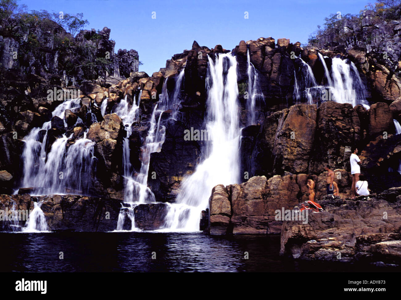 Travel Distrito Federal cascade waterfall chapada dos veadeiros national park people person tourists touristic rock white water - Stock Image
