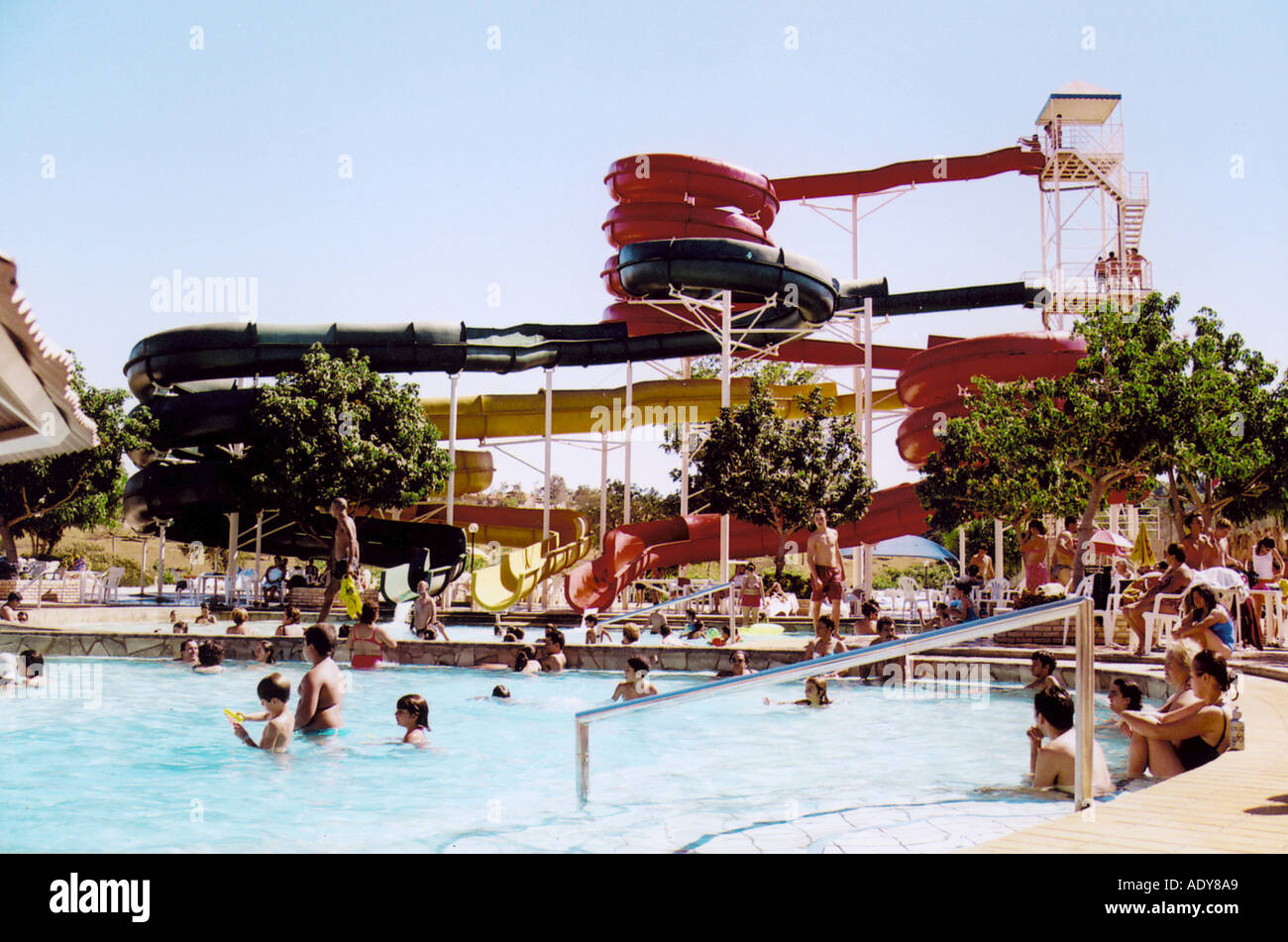 Travel Distrito Federal sun sunny park families people summer hot heat swim swimming bathing water slide caldas novas go trees t - Stock Image