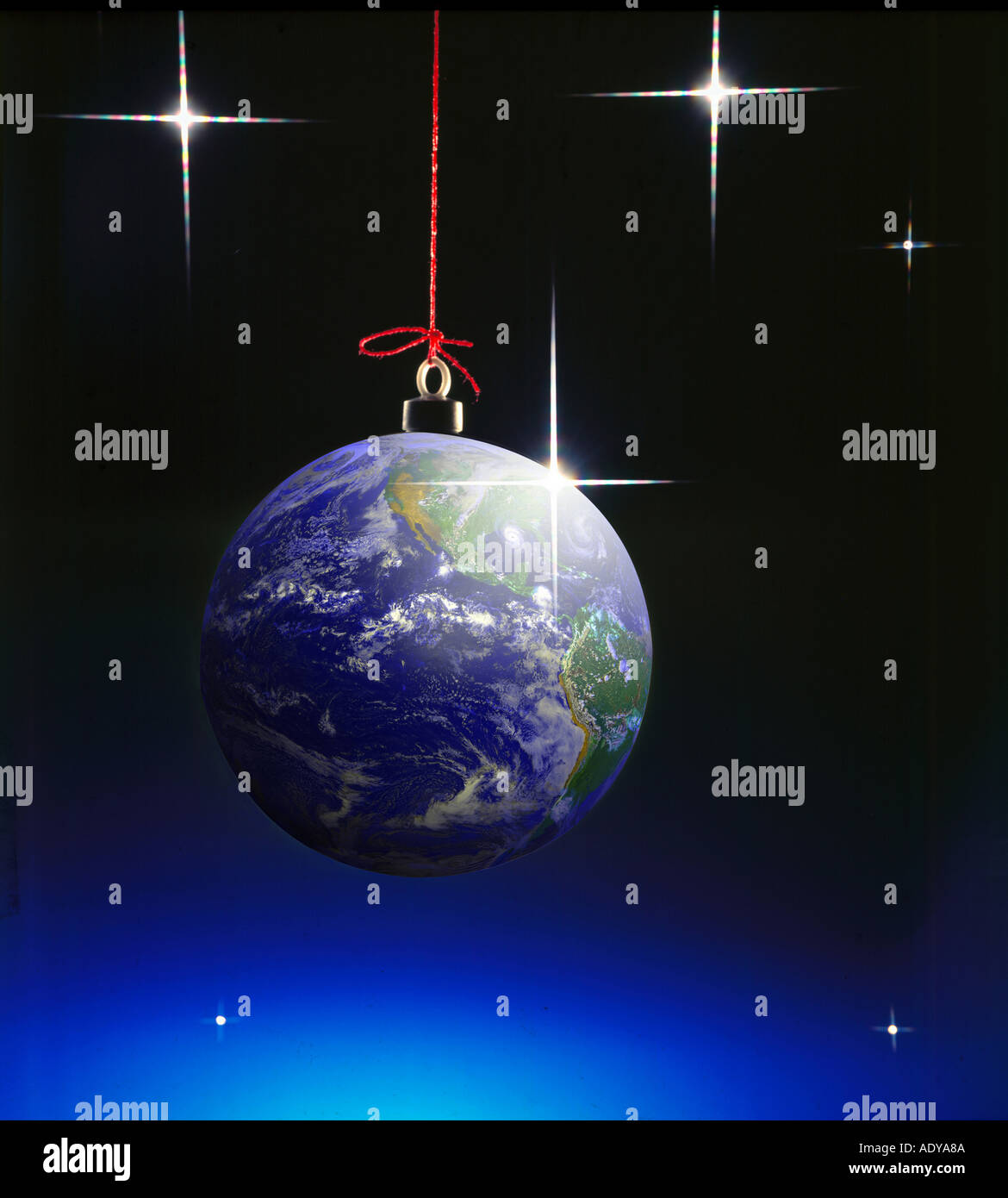 Celebrations I planet as christmas ball x mas hanging firmament star stars universal catholic holiday round void - Stock Image