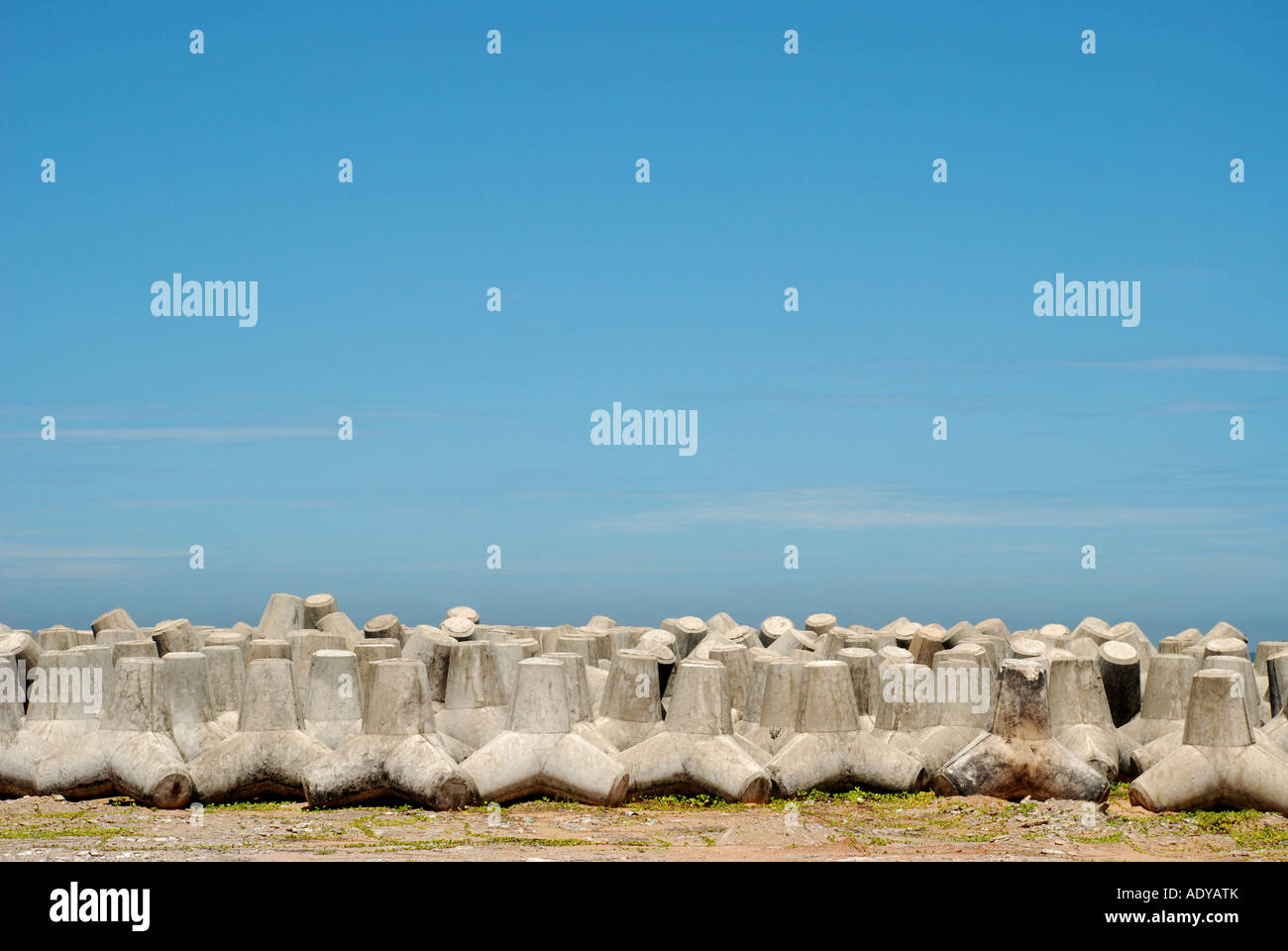 concrete  storn and blue sky in harber it use for sea wall - Stock Image
