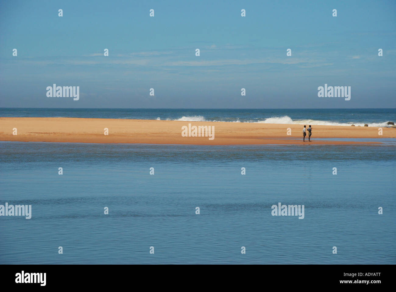 two man's waching the sea it is one joint place of sea and lake - Stock Image