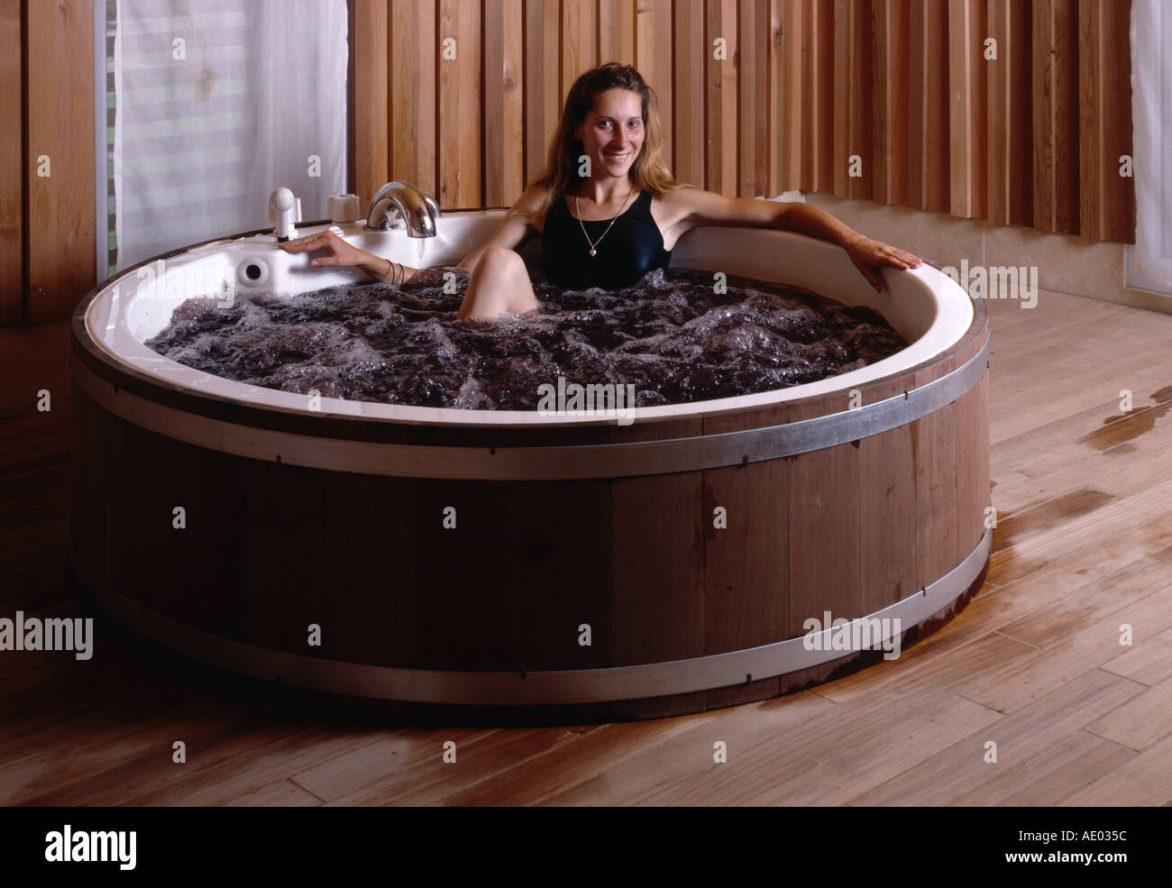 woman in barrel bath at les sources de caudalie wine spa at chateau stock photo 918364 alamy. Black Bedroom Furniture Sets. Home Design Ideas