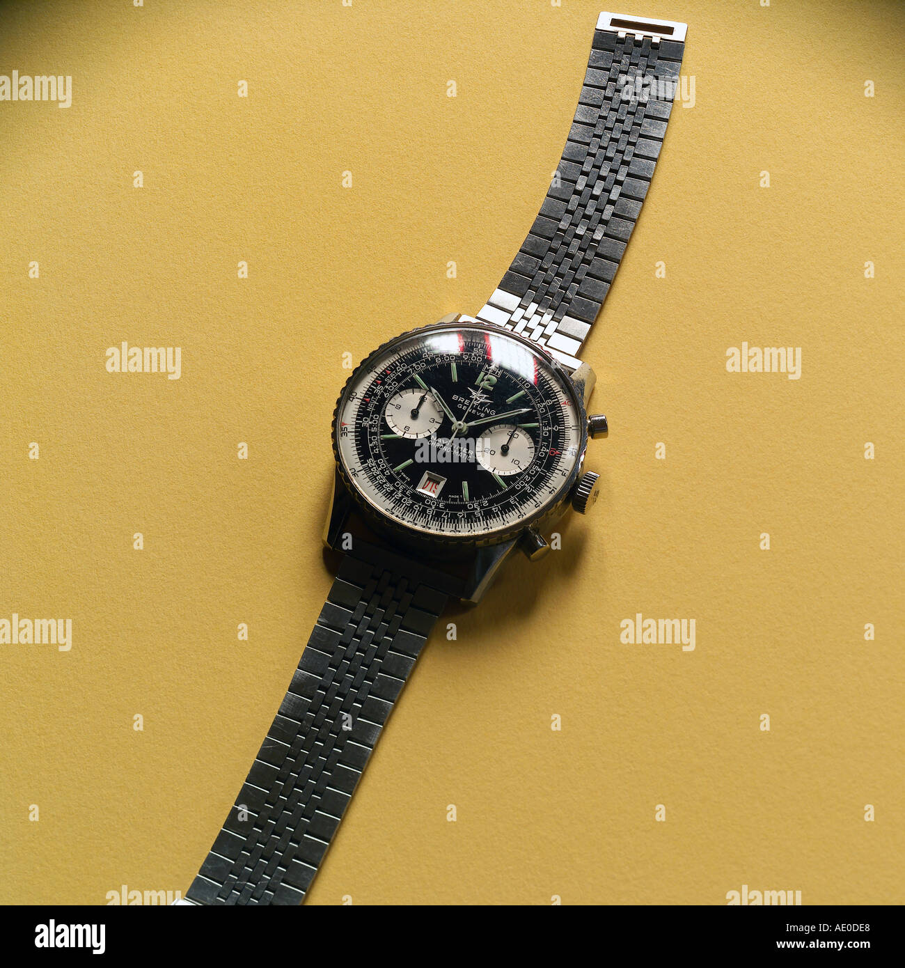 BREITLING SWISS CHRONOGRAPH WRIST WATCH ON YELLOW BACKGROUND - Stock Image