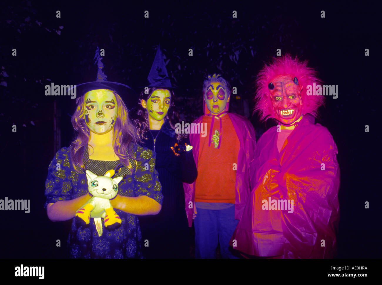 Four Children Aged 7 8 9 10 Years In Halloween Costumes