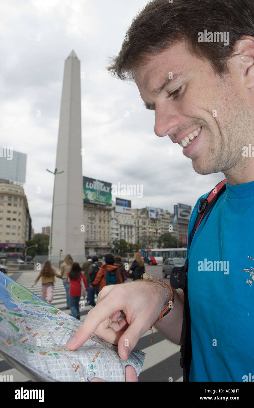 Man Looking at a Map by the Obelisk, Buenos Aires - Stock Image
