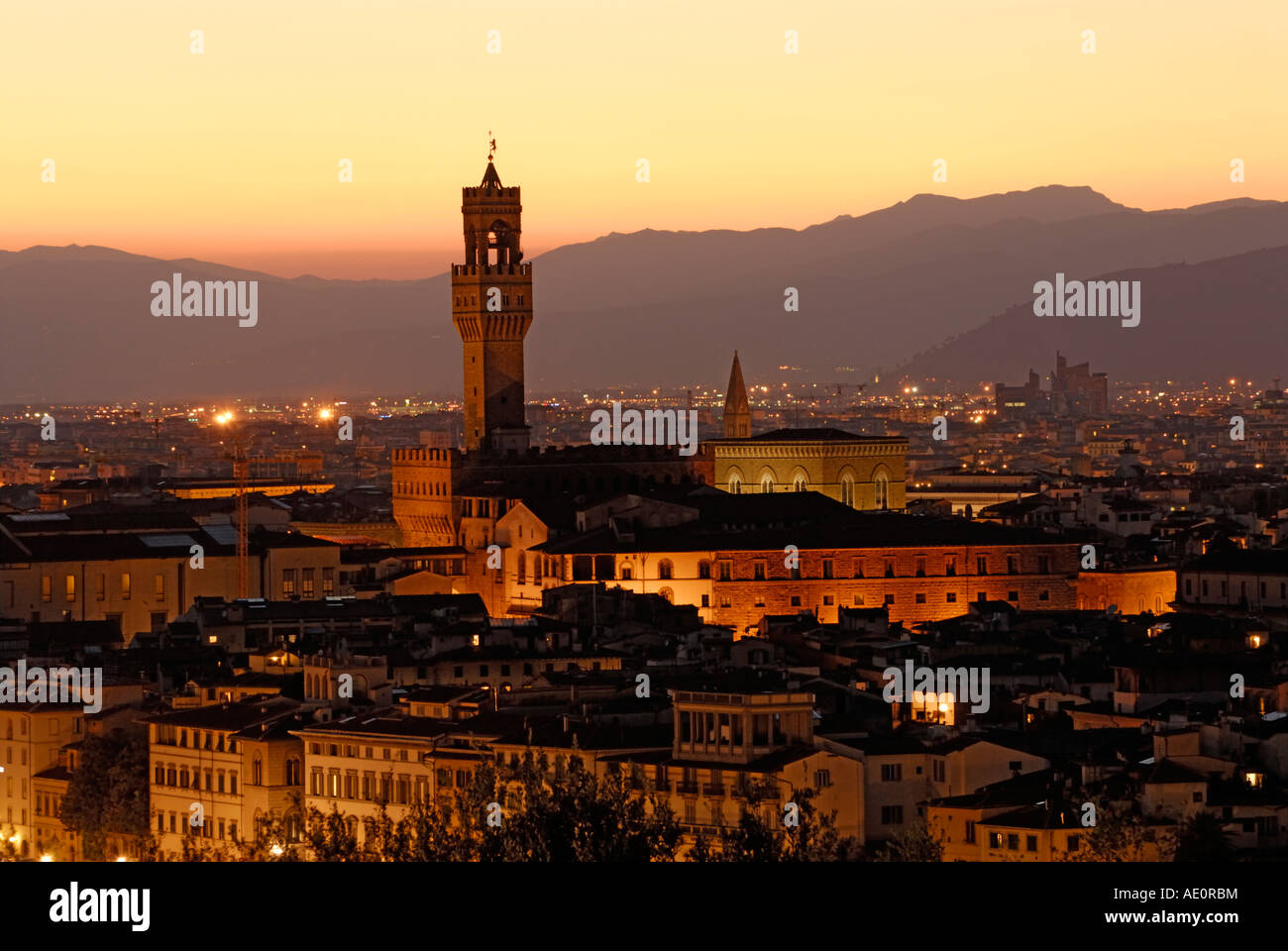 Florence skyline at night dusk with the tower of the Palazzo Vecchio - Stock Image