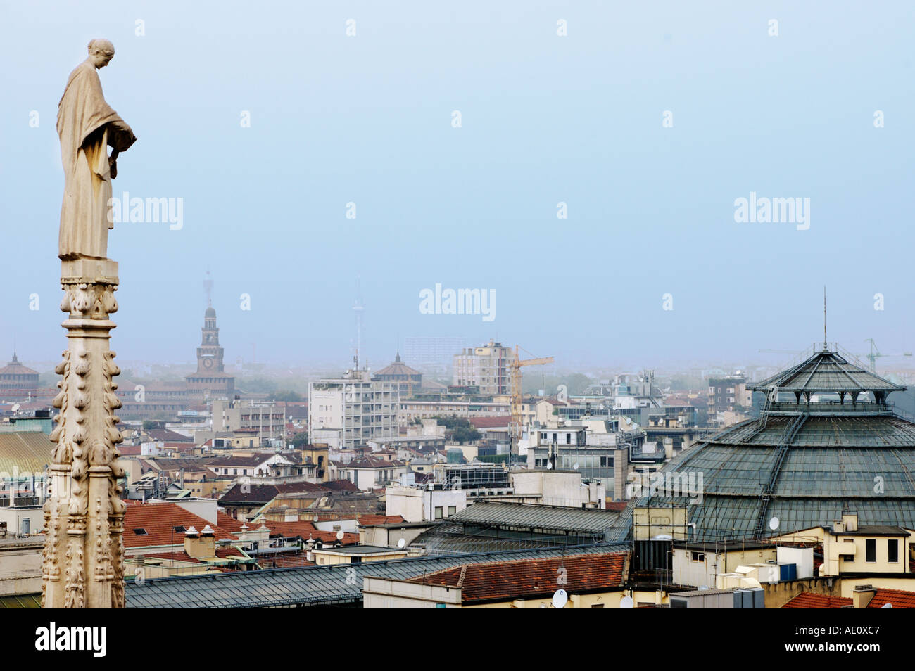 Italy, Milan, Statue and View of Milan from the Rooftop of the Duomo Stock Photo