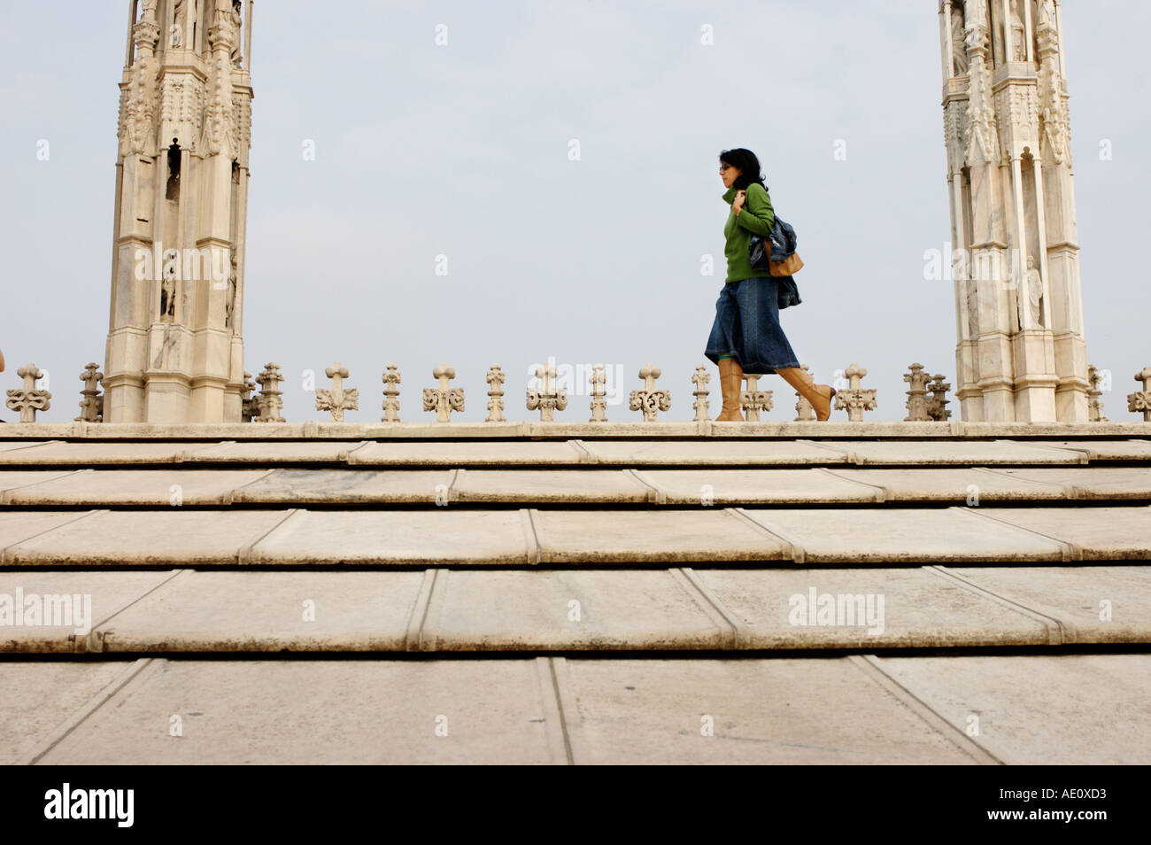 Italy, Milan, Woman on the Rooftop of the Duomo Stock Photo