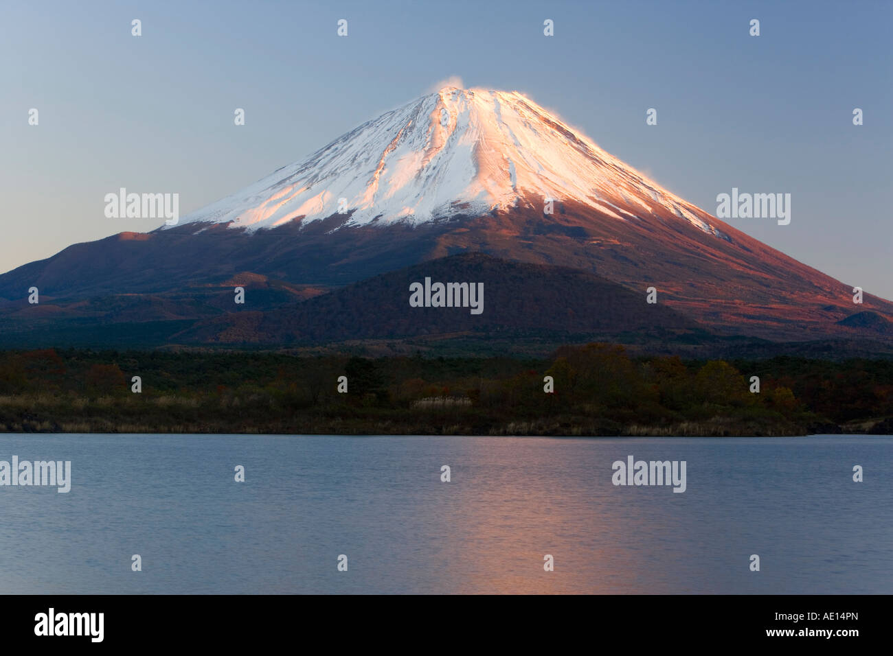 Japan Honshu Fuji Hakone Izu National Park Mount Fuji 3776m snow capped and viewed across lake Shoji ko in the Fuji - Stock Image
