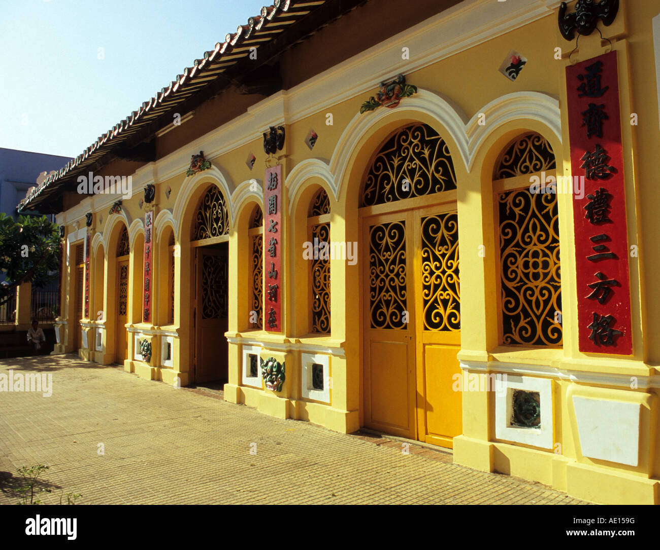 Arched doors and windows to the front of the Dinh Than Chau Phu Temple, Chau Doc, Viet Nam - Stock Image