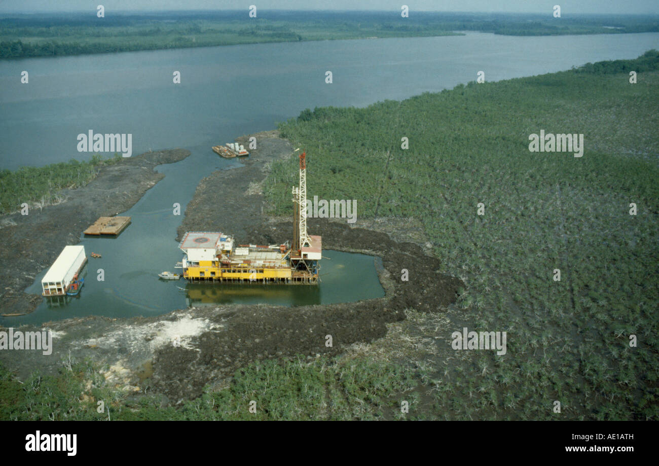 NIGERIA West Africa Rivers State Petroleum Industry Aerial view over oil rig drilling platform in swamp beside river - Stock Image