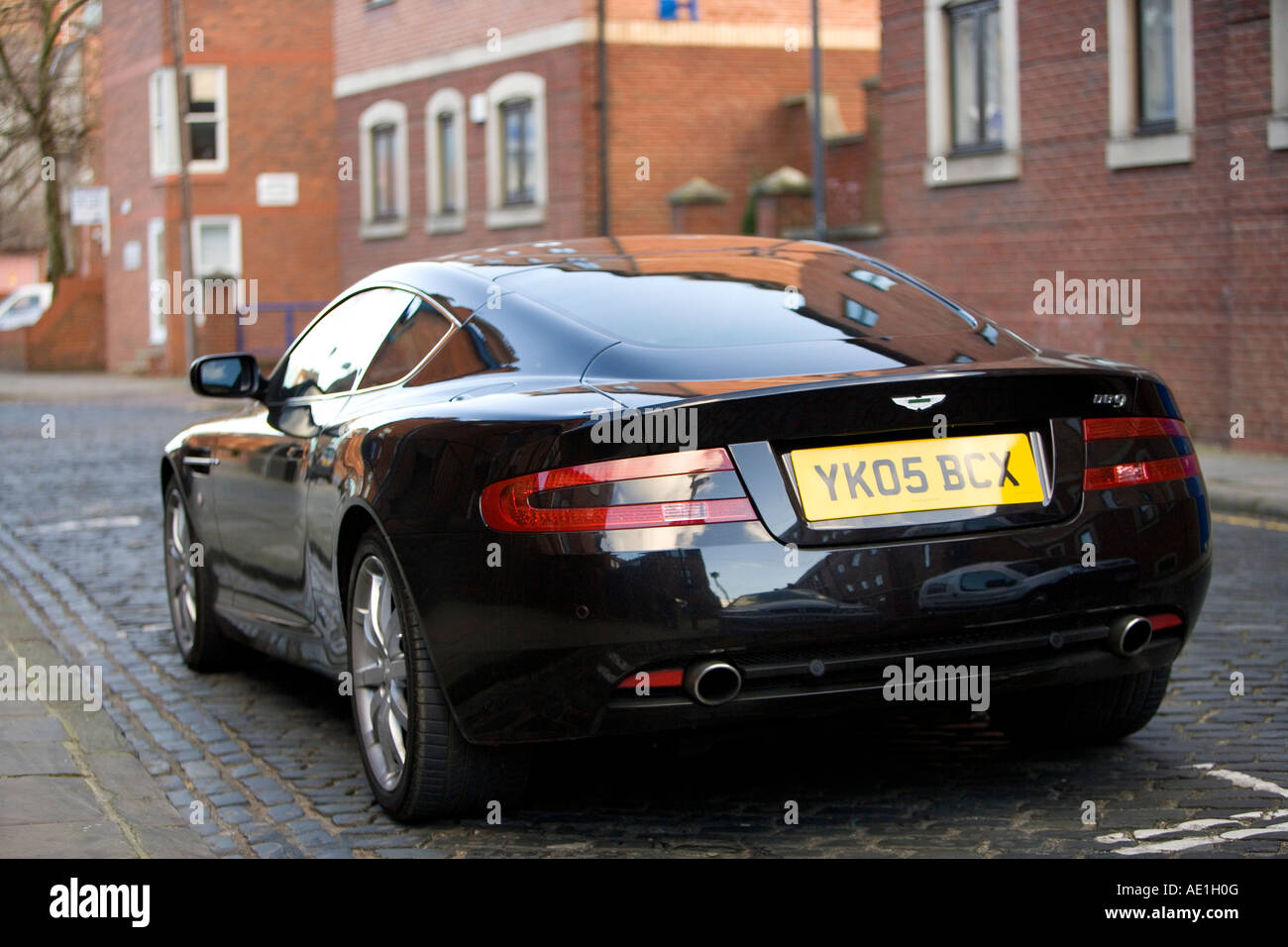 Black Aston Martin Db9 Grand Tourer Parked In Urban Town Street With
