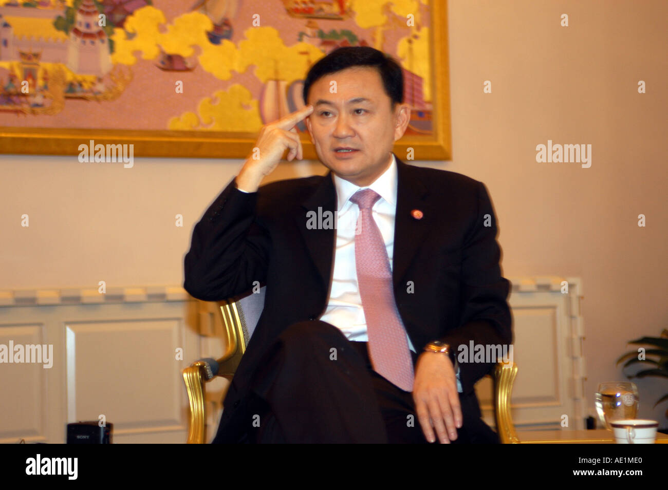 Prime Minister of Thailand Thaksin Shinawatra talks at Government House - Stock Image