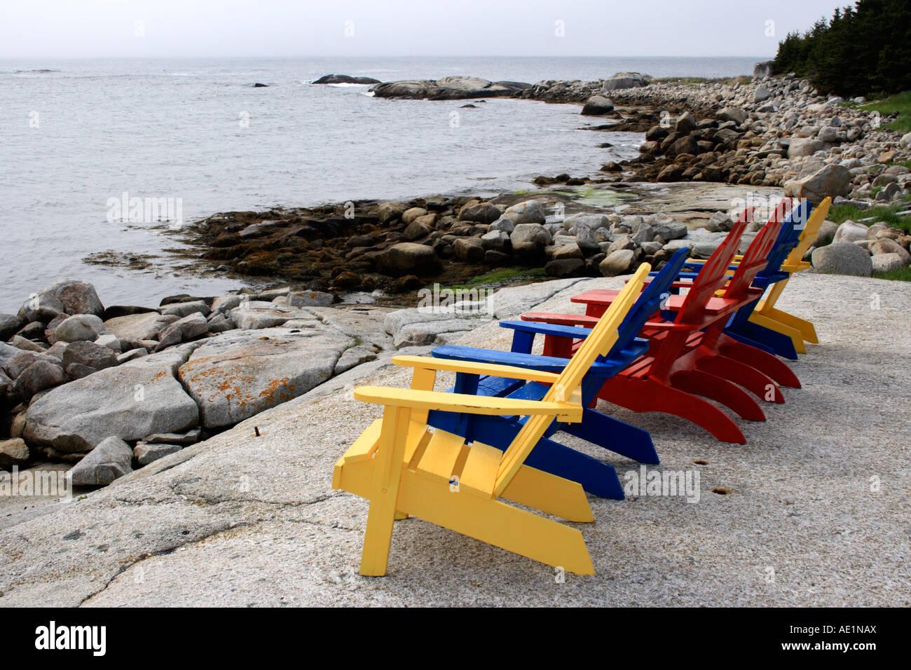 colored Adirondack chairs on the beach of Nova Scotia ...