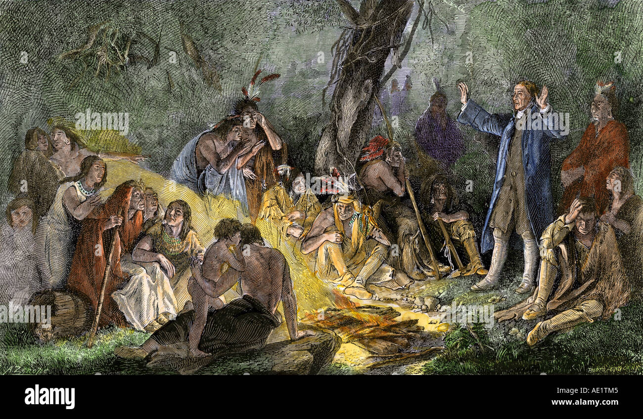 Moravian missionary David Zeisberger preaching to the Indians in the wilds of Pennsylvania. Hand-colored woodcut - Stock Image