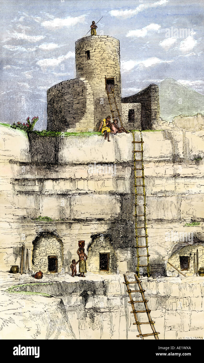 Prehistoric cliff-dwellings and masonry tower in the Southwest, a restoration. Hand-colored woodcut - Stock Image