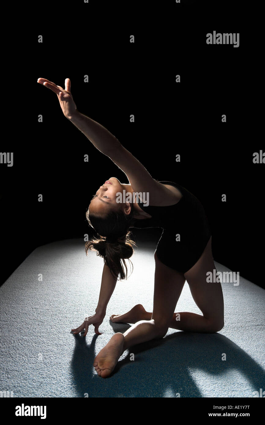 Ballet gymnast gymnastic dancer on floor - Stock Image