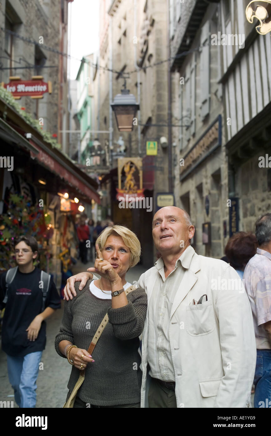 Mature couple visiting Mont St-Michel mount Normandy France Europe - Stock Image