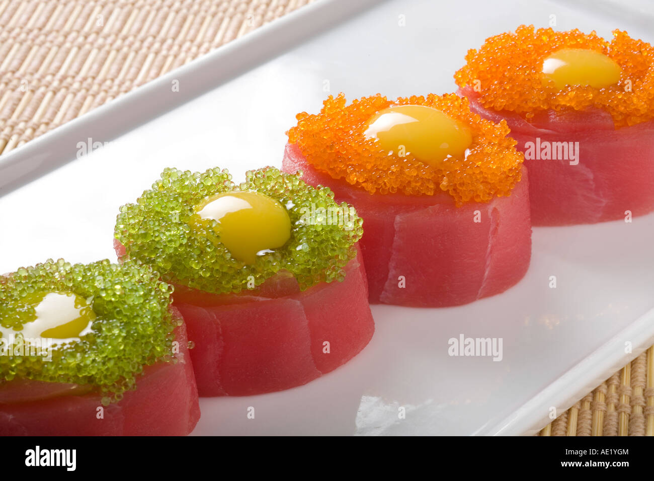 A Japanese dish on a plate consisting of 4 pieces of sushi. - Stock Image