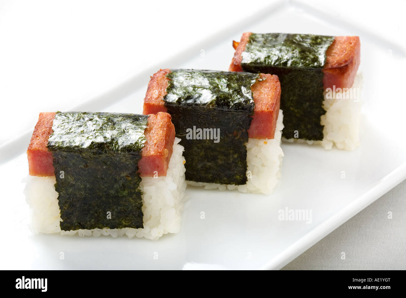 A Japanese dish on a plate consisting of three pieces of rice wraps. - Stock Image