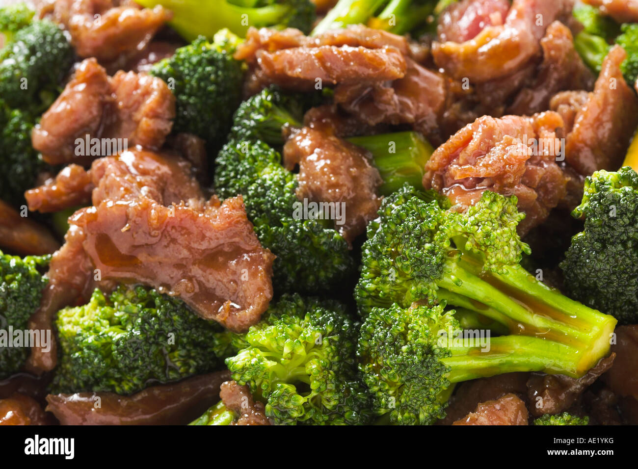Mongolian beef brocolli brocoli broccoli oyster sauce chinese food with seeds seed dish white plate delicious mouth - Stock Image
