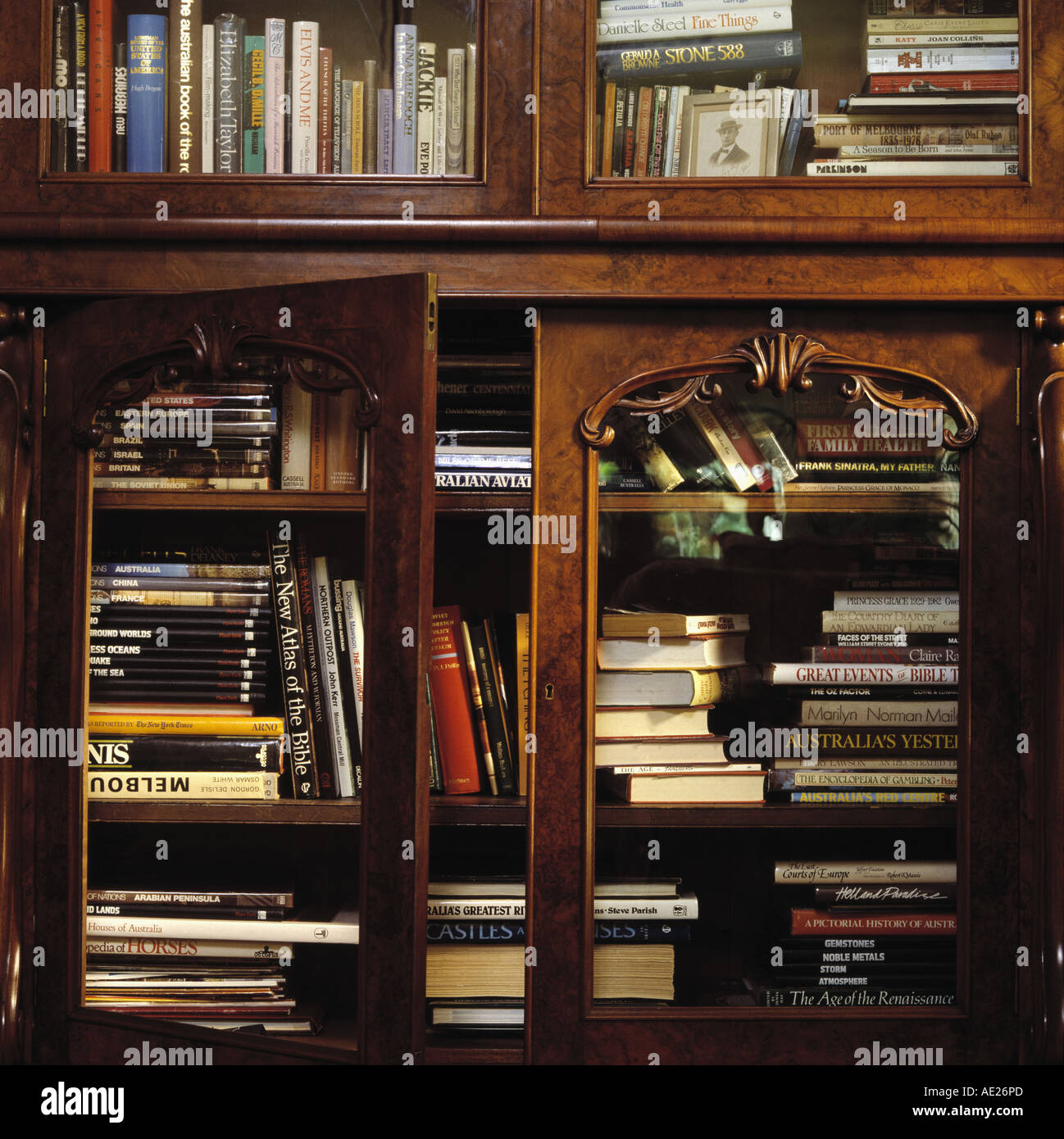 Close Up Of Books In Antique Mahogany Bookcase With Glass Doors Stock Photo Alamy