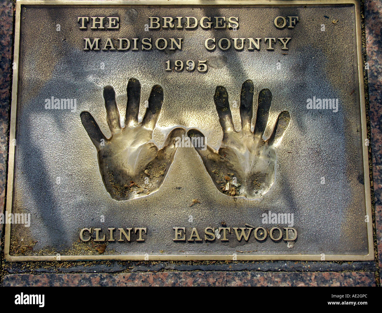 Hand palm prints of Clint Eastwood in the pavement outside the Odeon cinema  Leicester Square London England - Stock Image