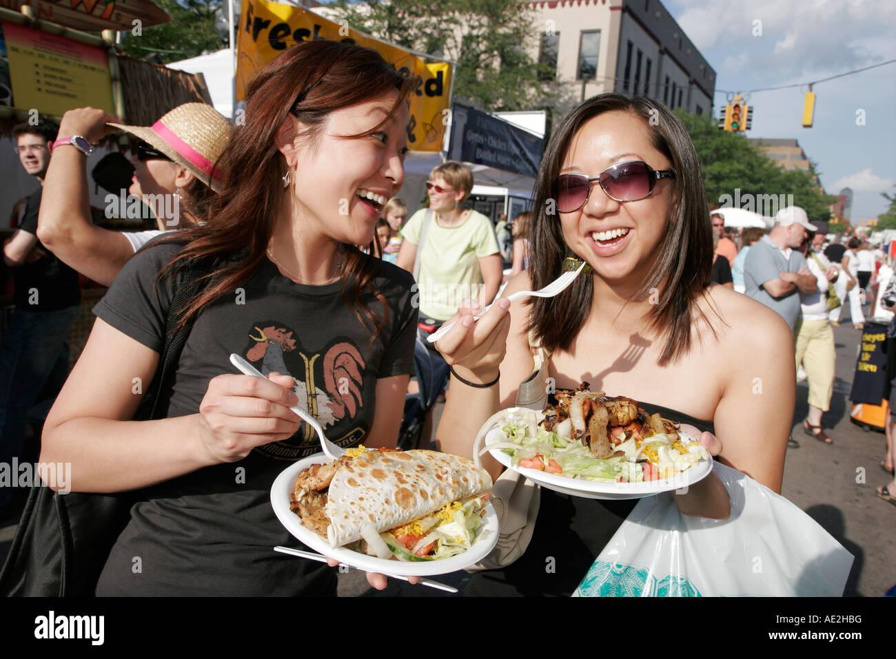 Michigan Ann Arbor Liberty Street Art Fairs happy Asian women food - Stock Image