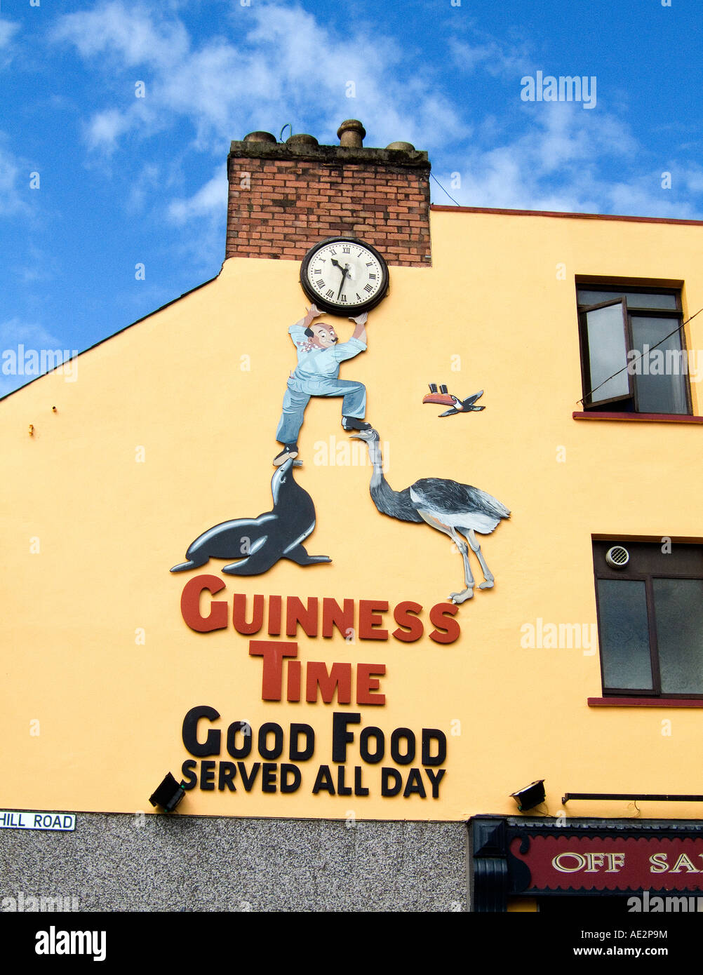 Guinness beer stout advertising sign clock on pub wall in street in ...