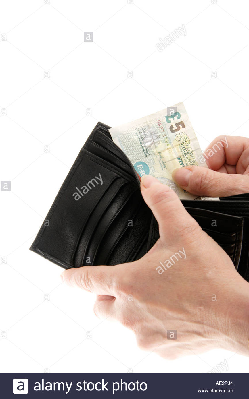 Taking a £5 note out of a wallet, UK. - Stock Image