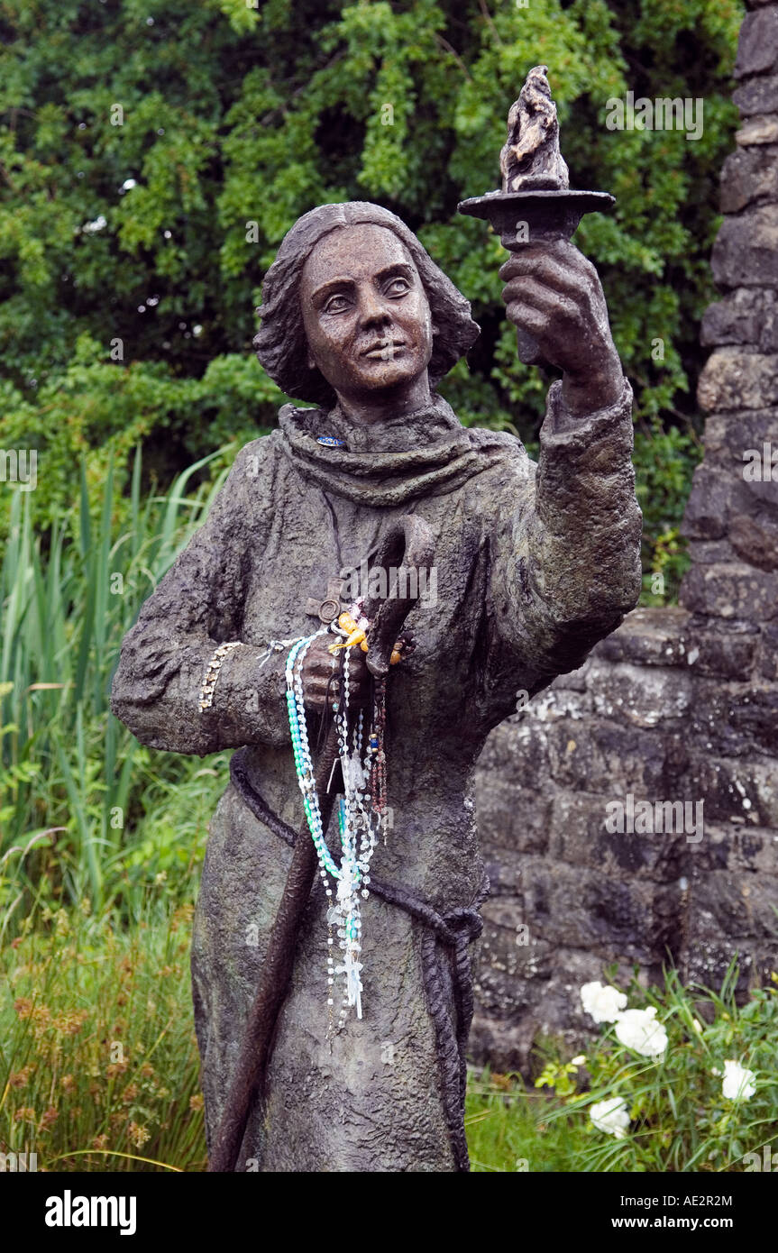 Statue. St. Brigid holding the flame at St. Brigid's Holy Well, early pagan and Celtic Christian site, County Kildare, - Stock Image