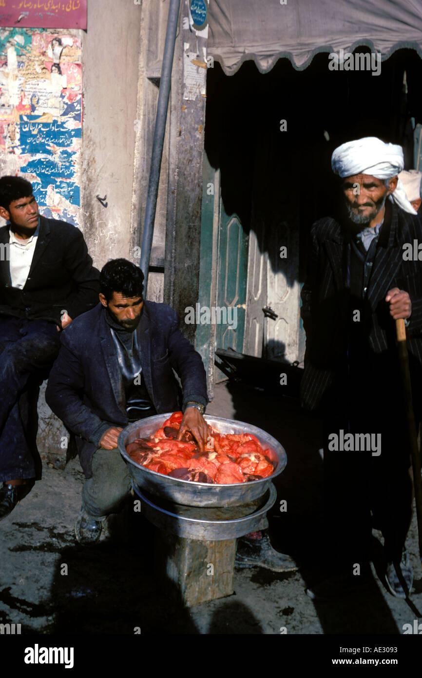 Afghanistan, Street scene with meat vendor, Herat Stock Photo