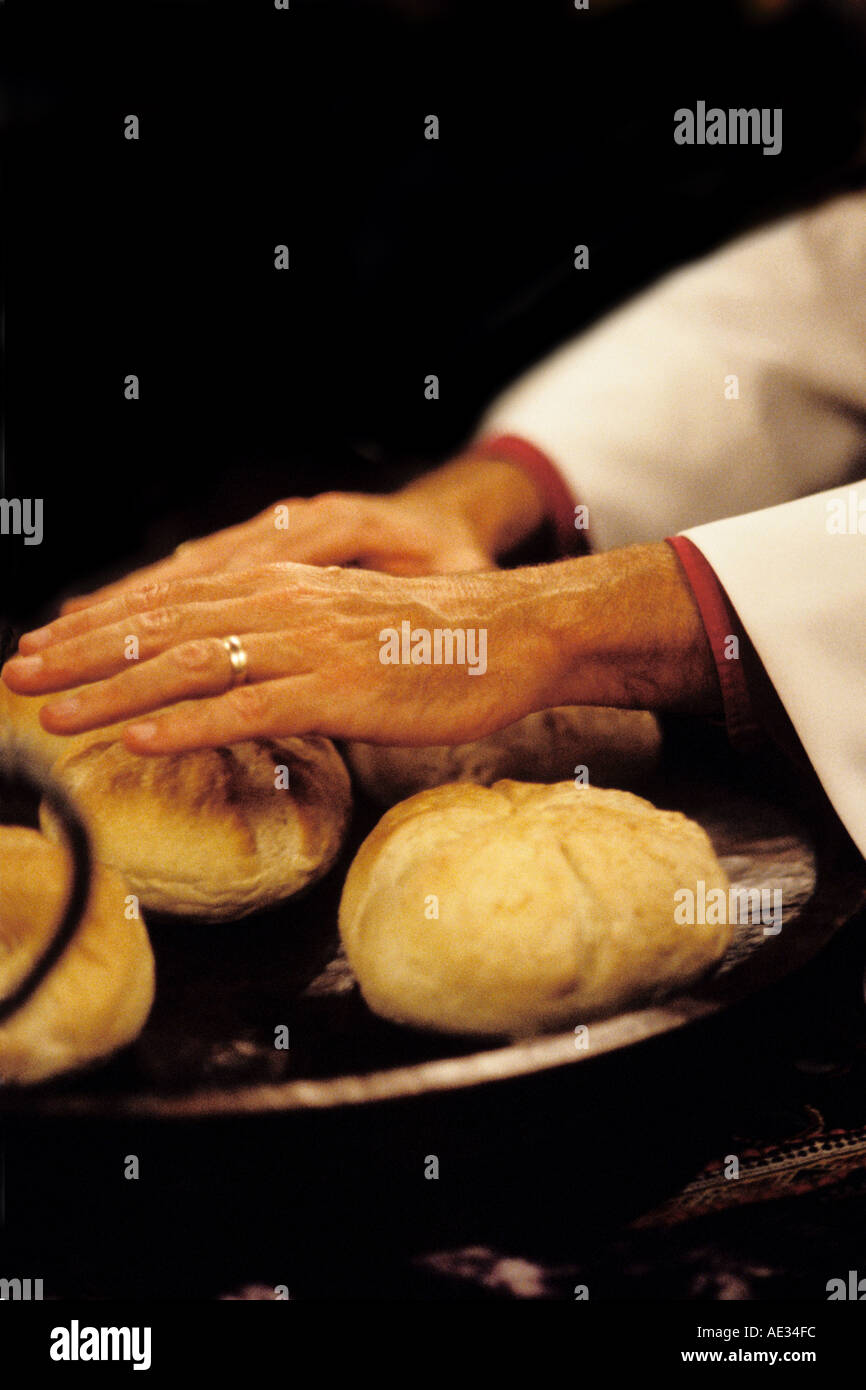 California, San Francisco, Bishops hands blessing bread, Stock Photo