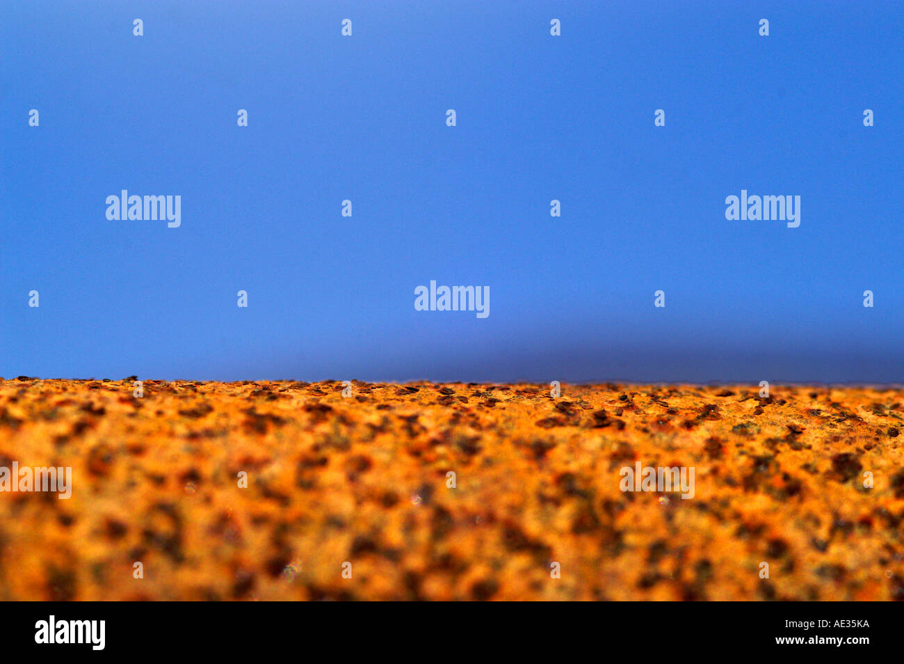 Rusty metal and blue sky, resemblance of Martian environment after huge  terraforming - Stock Image